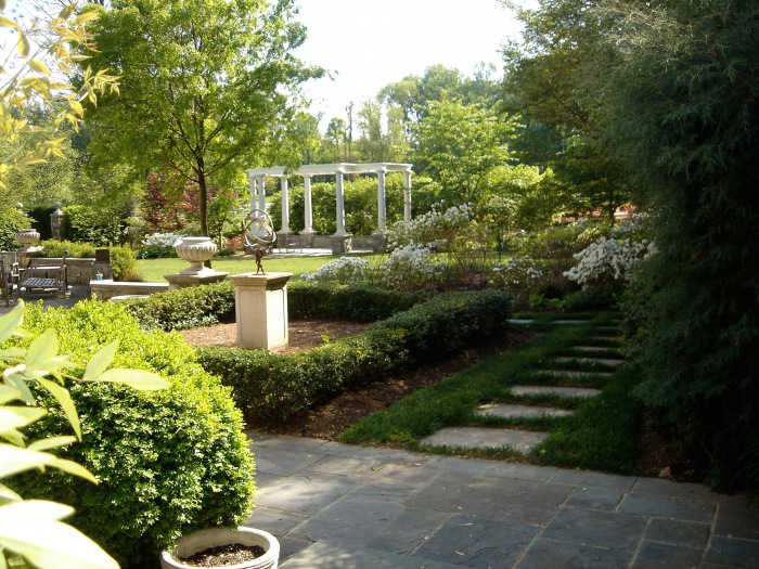 PHOTO-Formal garden with sundial and arbor